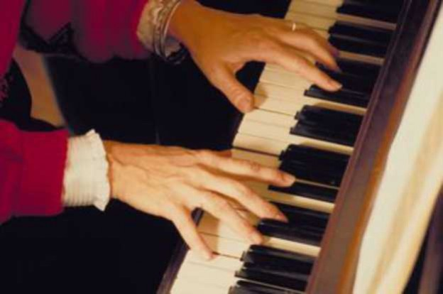 Adult playing the piano